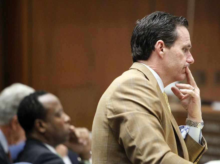 Defense attorney Edward Chernoff questions Robert Russell, a former patient of Conrad Murray, during Murray's involuntary manslaughter trial in downtown Los Angeles, Friday, Sept. 30, 2011. (AP Photo/Al Seib, Pool)