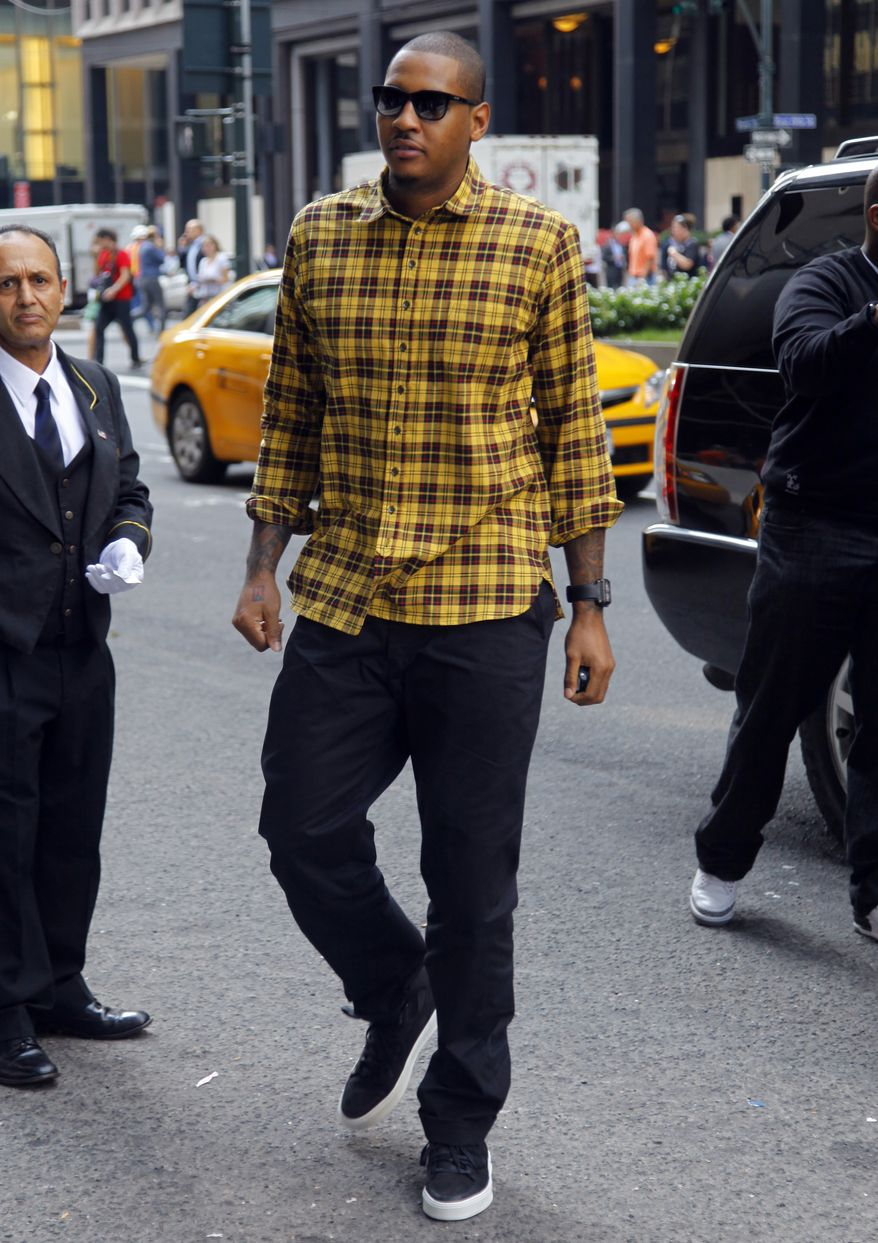 New York Knicks' Carmelo Anthony arrives for a meeting with the NBA's owners' labor relations committee and the players' union's executive committee on Friday, Sept. 30, 2011 in New York. AP Photo/Bebeto Matthews)