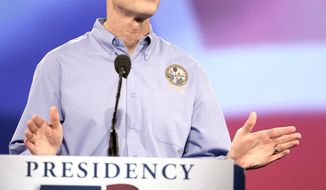 **FILE** Florida Gov. Rick Scott, the keynote speaker at a Florida Republican Party Presidency 5 convention, delivers a speech on Sept. 24, 2011, in Orlando, Fla. (Associated Press)