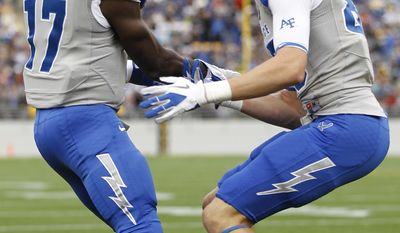 Air Force running back Asher Clark (17) celebrates his 23-yard touchdown run with wide receiver Zack Kauth, right, during the second quarter of an NCAA college football game against Navy, Saturday, Oct 1, 2011, in Annapolis, Md. (AP Photo/Luis M. Alvarez)