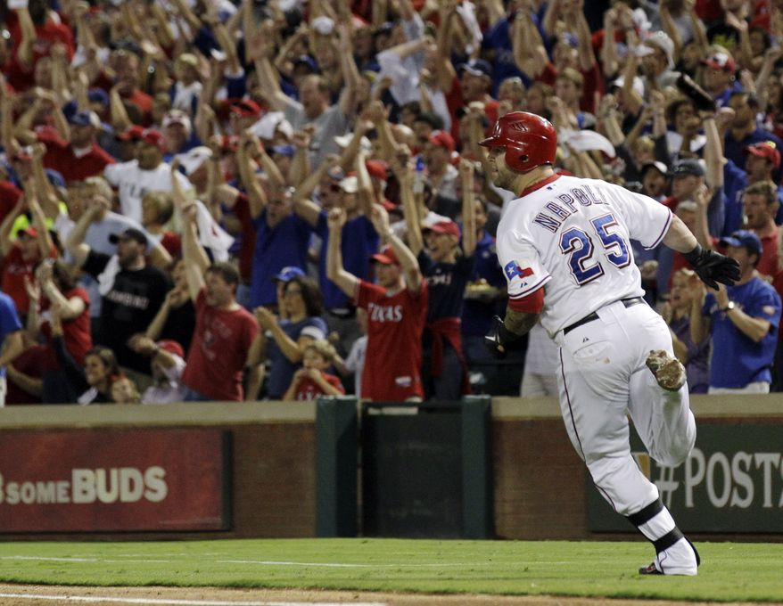 Texas Rangers' Mike Napoli (25) heads to first as the crowd reacts to his two-run single during the fourth inning against the Tampa Bay Rays at Game 2 of baseball's American League division series playoffs, Saturday, Oct. 1, 2011, in Arlington, Texas. (AP Photo/Tony Gutierrez)
