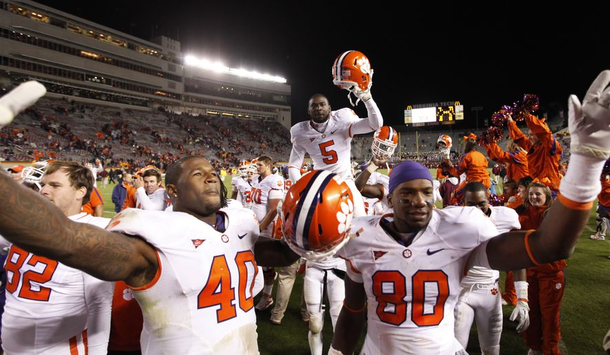 Clemson defensive end Andre Branch (40) and tight end Brandon Ford (80) celebrate their 23-3 win over Virginia Tech during an NCAA college football game at Lane Stadium in Blacksburg, Va., Saturday, Oct. 1, 2011. (AP Photo/Steve Helber)
