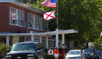 ** FILE ** Mothers arrive to pick up their children from Flowers School in Montgomery, Ala. (Associated Press)