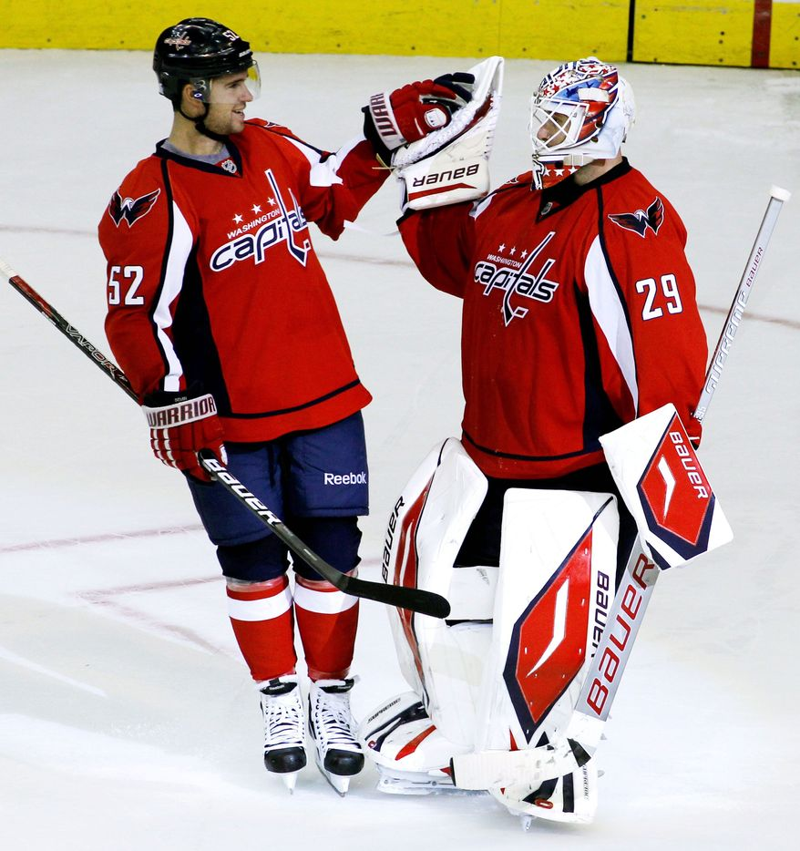Washington's Mike Green celebrates with goalkeeper Tomas Vokoun on Friday after the Capitals defeatied the Buffalo Sabres 4-3 in a preseason shootout. Green says it's only natural for the team, especially veterans, to ramp up the intensity as the regular season approaches. (Associated Press)