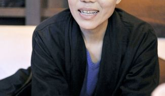 Liu Xia, wife of imprisoned Nobel Peace Prize laureate Liu Xiaobo, is cut off from the outside world by the Chinese government. (Kyodo News via Associated Press)