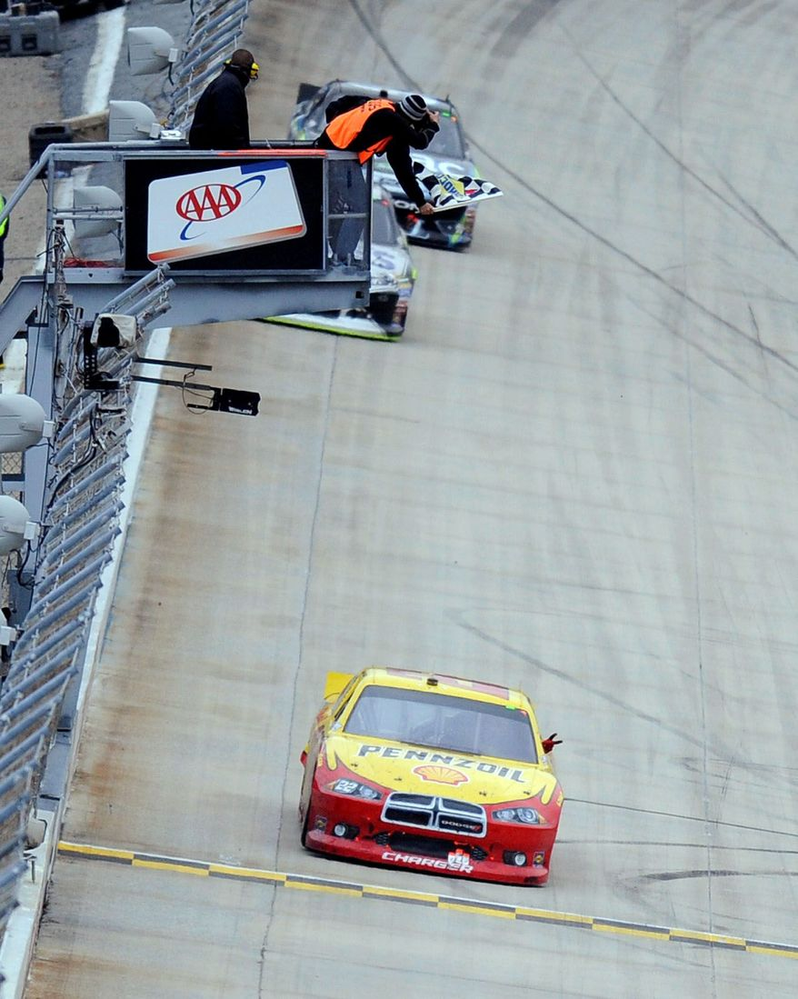 Kurt Busch takes the checkered flag at Dover International Speedway to climb from ninth to fourth in the Chase for the Sprint Cup standings. (Associated Press)