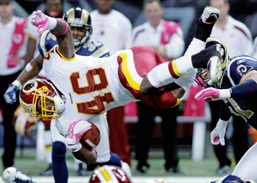 Redskins running back Ryan Torain goes airborne during the third quarter for seven of his 135 yards. His biggest play was a 20-yard touchdown run. (Associated Press)