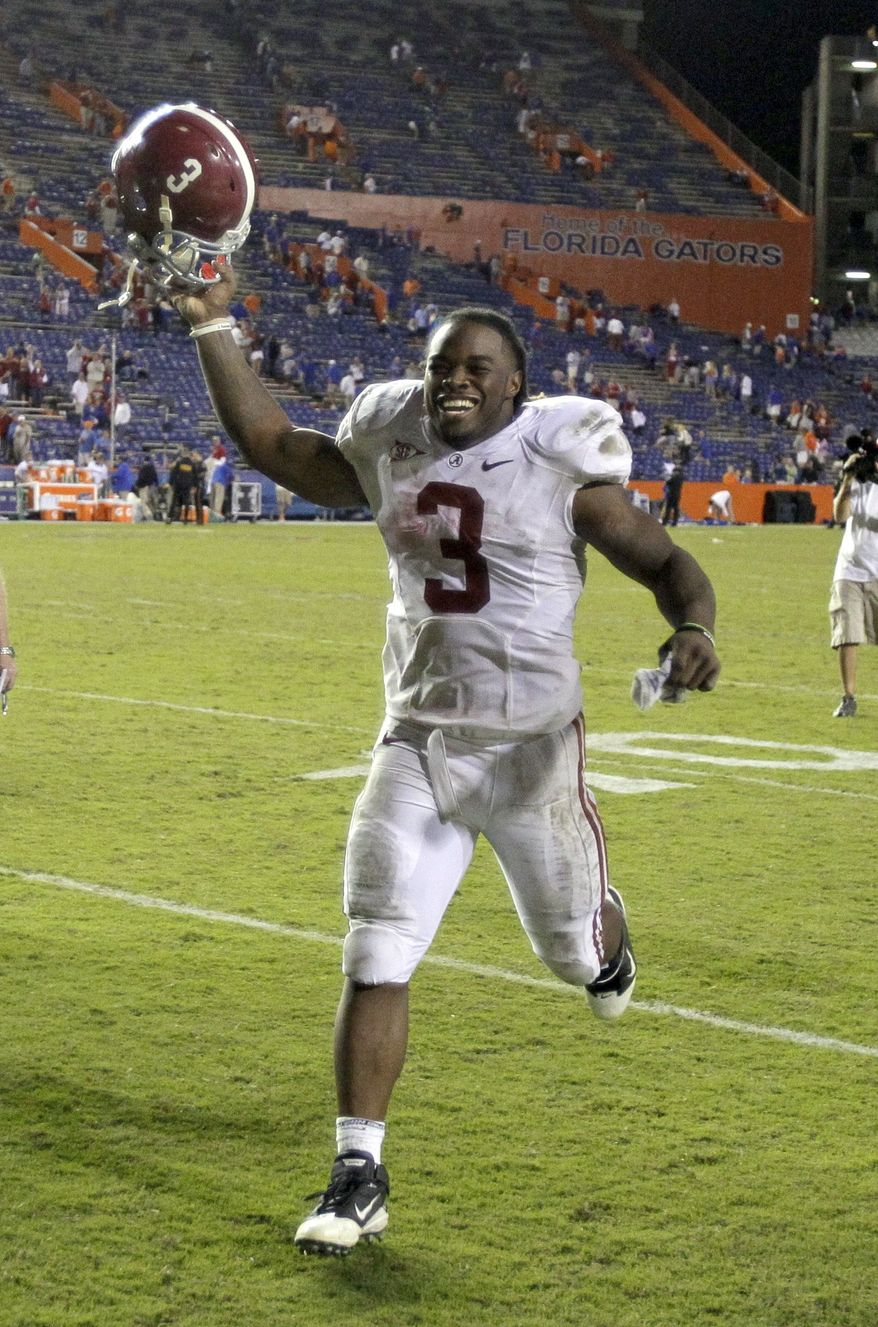 Alabama running back Trent Richardson celebrates as he runs off the field after Alabama defeated Florida 38-10 in an NCAA college football game Saturday, Oct. 1, 2011, in Gainesville, Fla. (AP Photo/John Raoux)