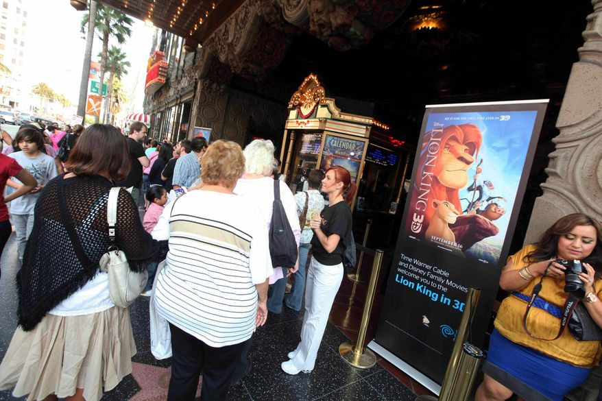 """** FILE ** In this Sept. 17, 2011, photo provided by Time Warner Cable, guests gather outside before a Time Warner Cable and Disney screening of """"The Lion King"""" 3D at The El Capitan Theatre, in Los Angeles. (AP Photo/Time Warner Cable, Casey Rodgers)"""