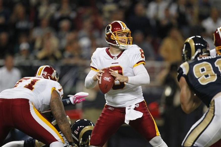 Washington Redskins quarterback Rex Grossman drops back to pass during the first quarter of the NFL football game against the St. Louis Rams Sunday, Oct. 2, 2011, in St. Louis. (AP Photo/Jeff Roberson)