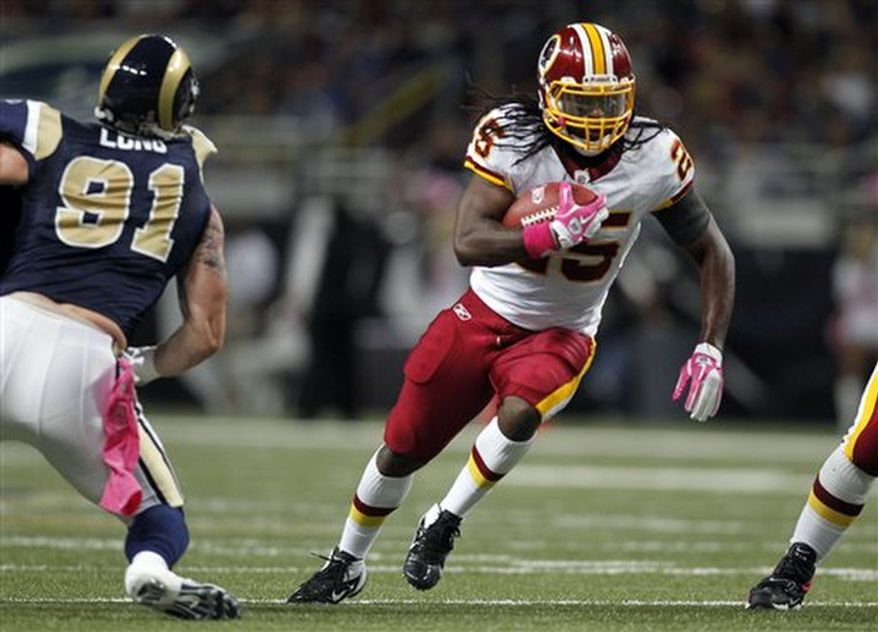 Washington Redskins running back Tim Hightower, right, runs past St. Louis Rams defensive end Chris Long, left, for a 6-yard gain during the first quarter of the NFL football game Sunday, Oct. 2, 2011, in St. Louis. (AP Photo/Jeff Roberson)