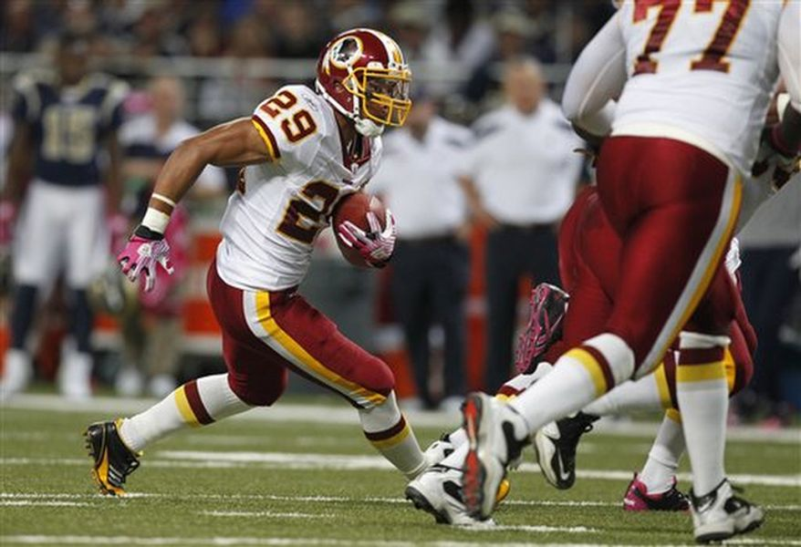 Washington Redskins running back Roy Helu runs for a 9-yard gain during the first quarter of the NFL football game against the St. Louis Rams Sunday, Oct. 2, 2011, in St. Louis. (AP Photo/Jeff Roberson)