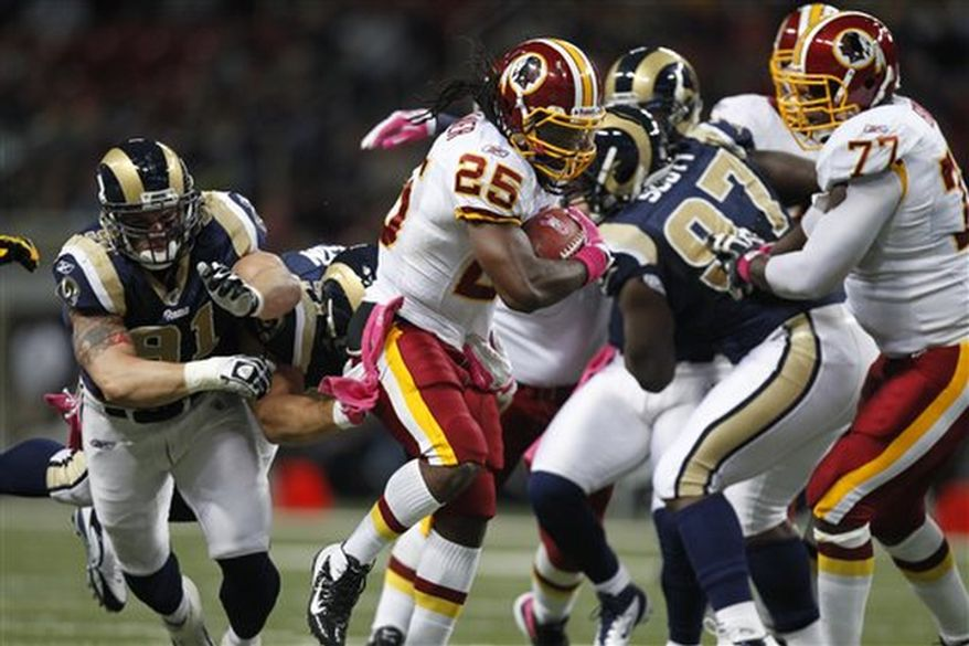 Washington Redskins running back Tim Hightower (25) runs for a 6-yard gain during the first quarter of the NFL football game against the St. Louis Rams on Sunday, Oct. 2, 2011, in St. Louis. (AP Photo/Jeff Roberson)