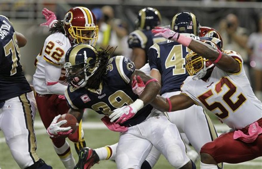 St. Louis Rams running back Steven Jackson runs for yardage past Washington Redskins defenders Kevin Barnes (22) and Rocky McIntosh (52) during the second quarter of the NFL football game Sunday, Oct. 2, 2011, in St. Louis. (AP Photo/Seth Perlman)