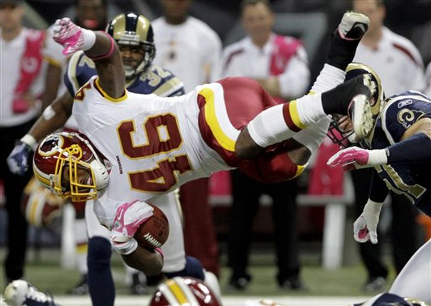 Washington Redskins running back Ryan Torain (46) flies through the air for a gain of 7-yards during the third quarter of the NFL football game against the St. Louis Rams Sunday, Oct. 2, 2011, in St. Louis. (AP Photo/Seth Perlman)