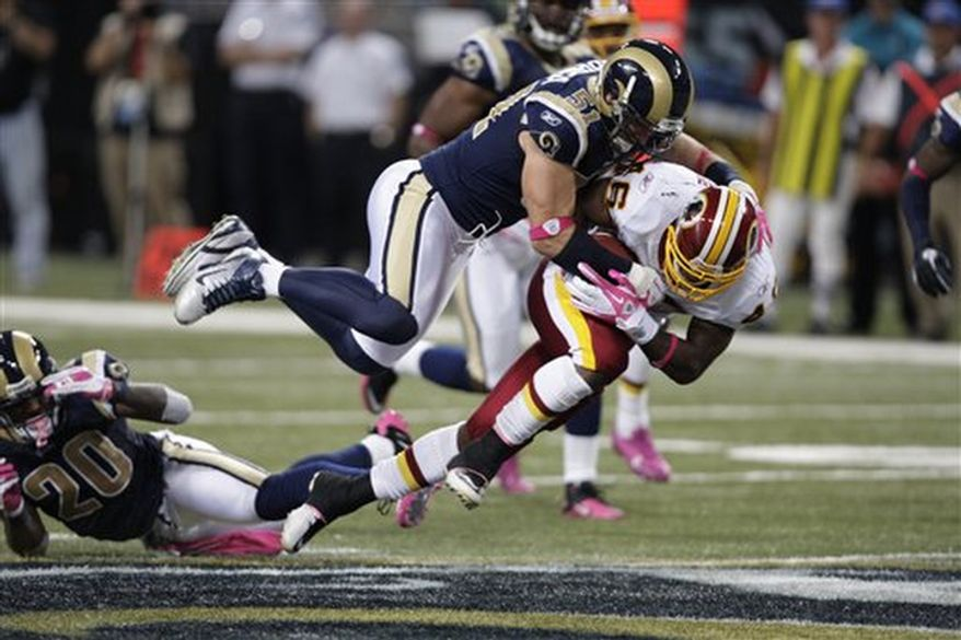 Washington Redskins running back Ryan Torain (46) is tackled by St. Louis Rams outside linebacker Brady Poppinga during the third quarter of the NFL football game Sunday, Oct. 2, 2011, in St. Louis. (AP Photo/Tom Gannam)