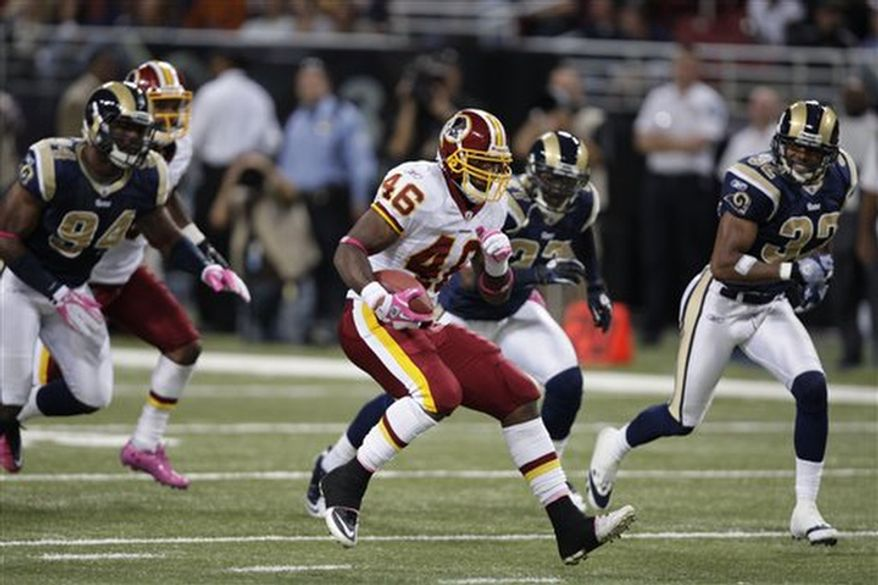 Washington Redskins running back Ryan Torain (46) runs with the ball during the third quarter of the NFL football game against the St. Louis Rams Sunday, Oct. 2, 2011, in St. Louis. (AP Photo/Tom Gannam)