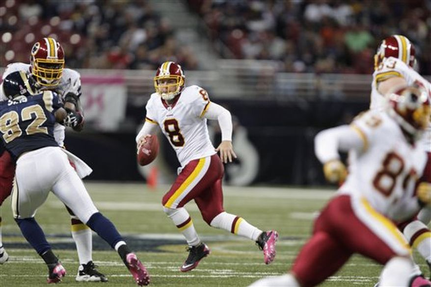 Washington Redskins quarterback Rex Grossman scrambles with the ball during the third quarter of the NFL football game against the St. Louis Rams Sunday, Oct. 2, 2011, in St. Louis. (AP Photo/Tom Gannam)