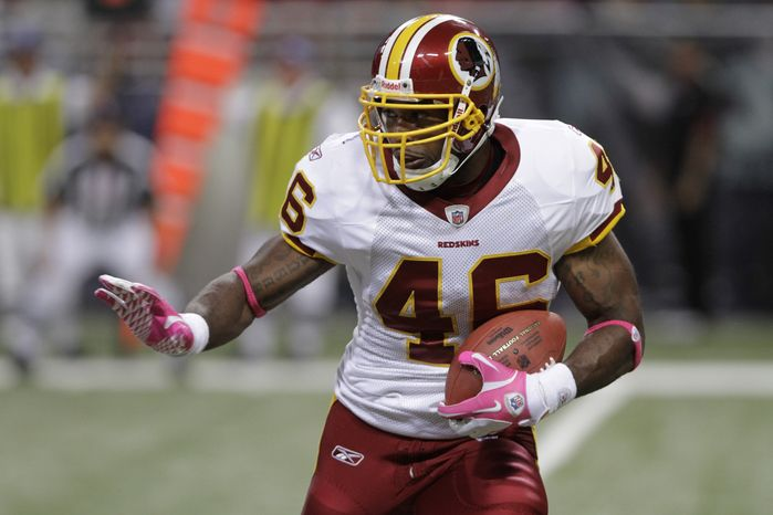 Washington Redskins running back Ryan Torain carries the ball during the third quarter of the NFL football game against the St. Louis Rams Sunday, Oct. 2, 2011, in St. Louis. (AP Photo/Seth Perlman)