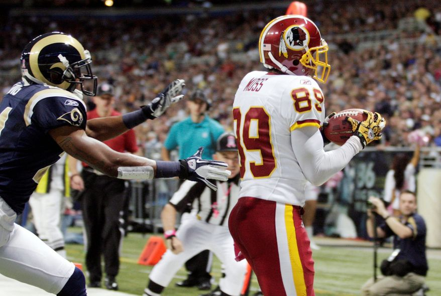Washington Redskins wide receiver Santana Moss, right, catches a 6-yard touchdown pass as St. Louis Rams cornerback Justin King defends during the first quarter of the NFL football game Sunday, Oct. 2, 2011, in St. Louis. (AP Photo/Tom Gannam)