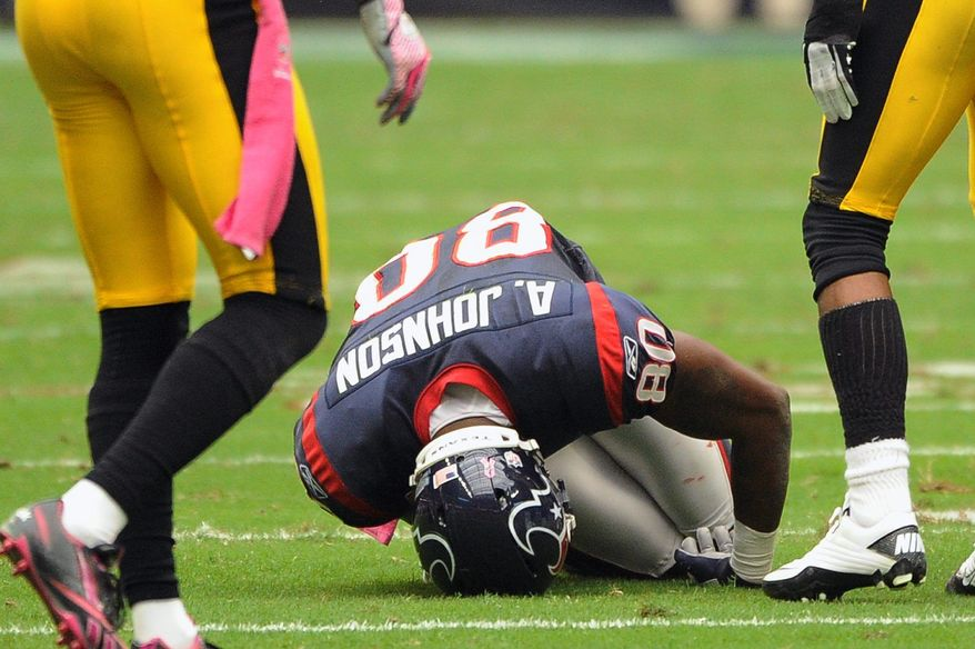 """Texans coach Gary Kubiak said Monday that Andre Johnson's injured hamstring would sideline the receiver anywhere from 3-4 days to a """"few weeks."""" (Associated Press)"""