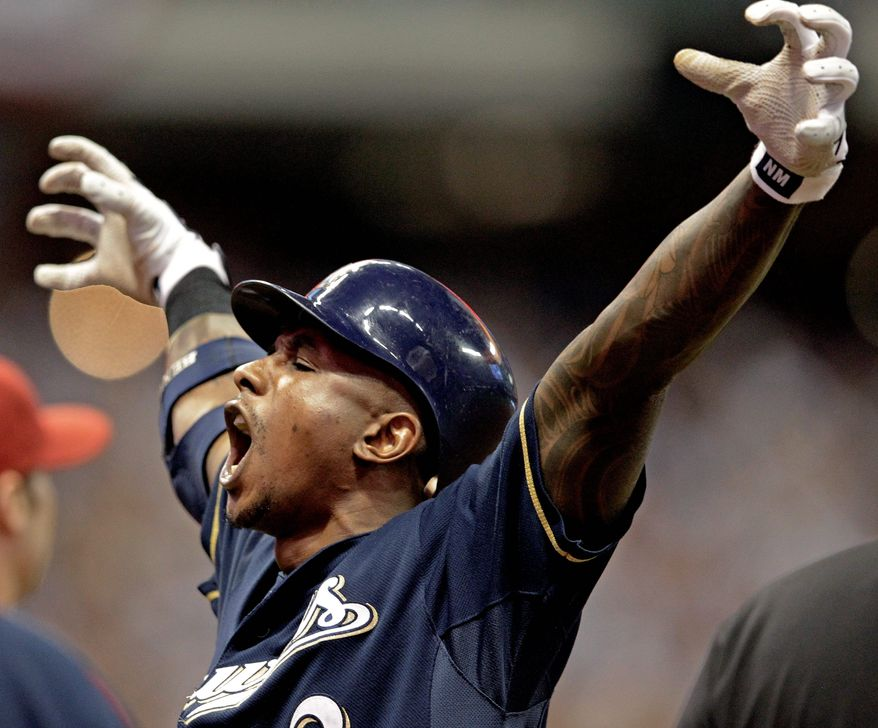 Milwaukee's Nyjer Morgan made a clutch catch against Arizona in Game 1 of their NL playoff series and delivered a two-run single in Game 2. The series shifts to Arizona for Game 3 on Tuesday. (Associated Press)