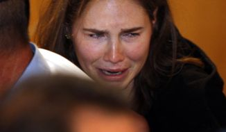 Amanda Knox breaks into tears Oct. 3, 2011, at the Perugia court in central Italy after hearing the verdict that overturned her 2009 conviction of murdering her British roommate. (Associated Press)