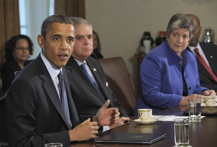 President Obama (left) speaks during a Cabinet meeting at the White House on Oct. 3, 2011. Seated next to the president are Transportation Secretary Ray LaHood (center) and Homeland Security Secretary Janet Napolitano. (Associated Press)