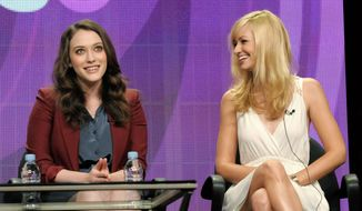 """2 Broke Girls"" co-stars Kat Dennings (left) and actress Beth Behrs say they're close friends in real life as well as their show. (Associated Press)"
