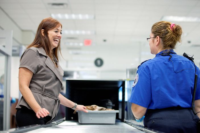 ** FILE ** In this 2011 file photo, passenger Donna Pederson (left) of Atlanta chats with Transportation Security Administration officer Myra Watts after going through a new expedited security line at Hartsfield-Jackson International Airport in Atlanta. (Associated Press)