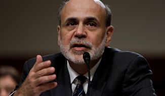 Ben Bernanke, chairman of the Board of Governors of the Federal Reserve, testifies before the Joint Economic Committee on the country's economic outlook at the U.S. Capitol in Washington on Oct. 4, 2011. (T.J. Kirkpatrick/The Washington Times)