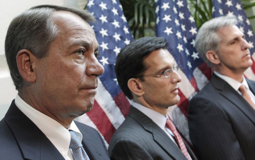 House Speaker John Boehner (left), Ohio Republican, accompanied by House Majority Leader Eric Cantor (center), Virginia Republican, and House Majority Whip Kevin McCarthy, California Republican, takes part Oct. 4, 2011, in a news conference on Capitol Hill to discuss China currency. (Associated Press)