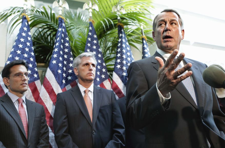 House Speaker John Boehner of Ohio, right, accompanied by House Majority Leader Eric Cantor of Va., left, and House Majority Whip Kevin McCarthy of Calif., gestures during a news conference on Capitol Hill in Washington, Tuesday, Oct. 4, 2011, where he dismissed a Senate bill that could punish China for undervaluing its currency. (AP Photo/J. Scott Applewhite)
