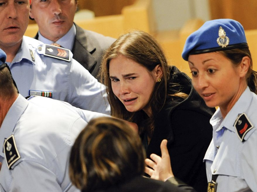 ** FILE ** Amanda Knox cries following the verdict on Monday, Oct. 3, 2011, by a Perugia, Italy, court that overturned her conviction and acquitted her of murdering her British roommate, Meredith Kercher. On Tuesday, March 26, 2013, her acquittal was overturned by the Italian courts. (AP Photo/Lapresse)