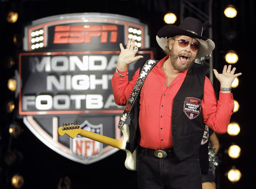 """**FILE** In this photo from July 14, 2011, Hank Williams Jr. performs during the recording of a promo for ESPN's broadcasts of """"Monday Night Football,"""" in Winter Park, Fla. (Associated Press)"""