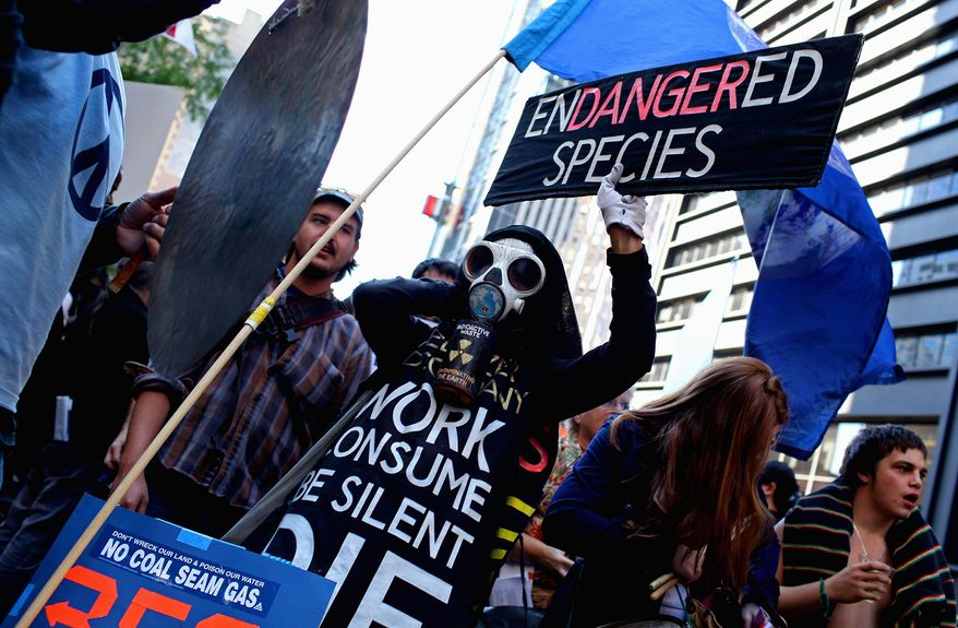 Protesters with Occupy Wall Street leave New York's Zuccotti Park on Wednesday to join a rally at City Hall. A diverse group of powerful unions joined the demonstrations near Wall Street. (Associated Press)
