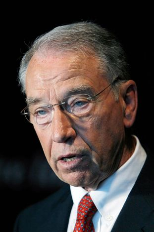 Sen. Chuck Grassley, Iowa Republican, wants to know why a well-traveled Justice official wasn't fired. (Associated Press)