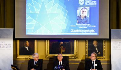 Members of the Swedish Royal Academy of Sciences from left, Lars Thelander, Staffan Normark and Sven Lidinin announce Israeli scientist Daniel Shechtman's 2011 Nobel Prize in chemistry for his discovery of quasicrystals, a chemical structure that researchers previously thought was impossible, in Stockholm, Wednesday, Oct. 5, 2011. (AP Photo/Scanpix, Henrik Montgomery)