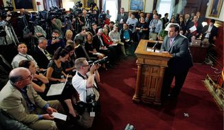 """New Jersey Gov. Chris Christie announces on Tuesday at the Statehouse in Trenton, N.J., that he will not run for president in 2012. """"I have a commitment to New Jersey that I simply will not abandon. That's the promise I made to the people of this state when I took office 20 months ago, to fix a broken New Jersey,"""" he said. (Associated Press)"""
