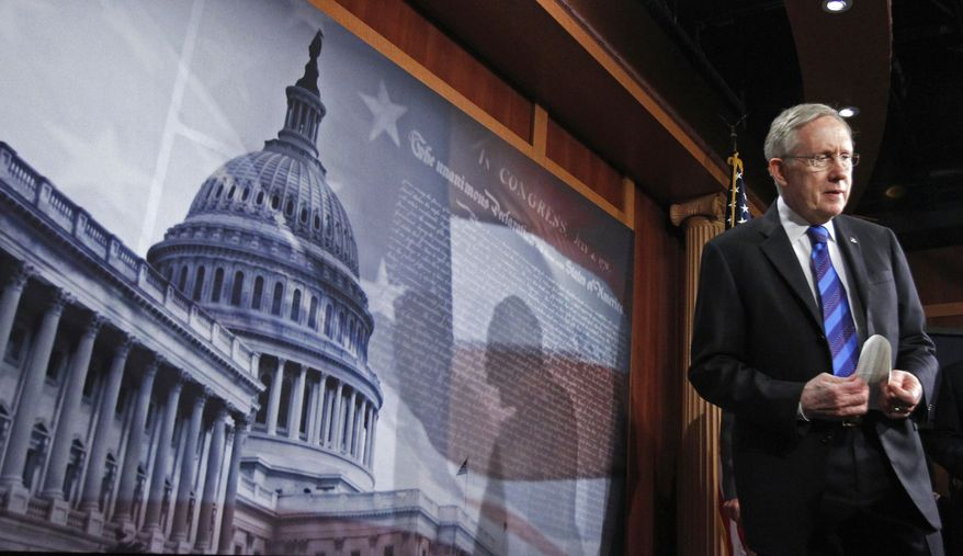 **FILE** Senate Majority Leader Sen. Harry Reid, Nevada Democrat, arrives for a news conference on Capitol Hill on Oct. 5, 2011, to discuss President Obama's jobs bill. (Associated Press)