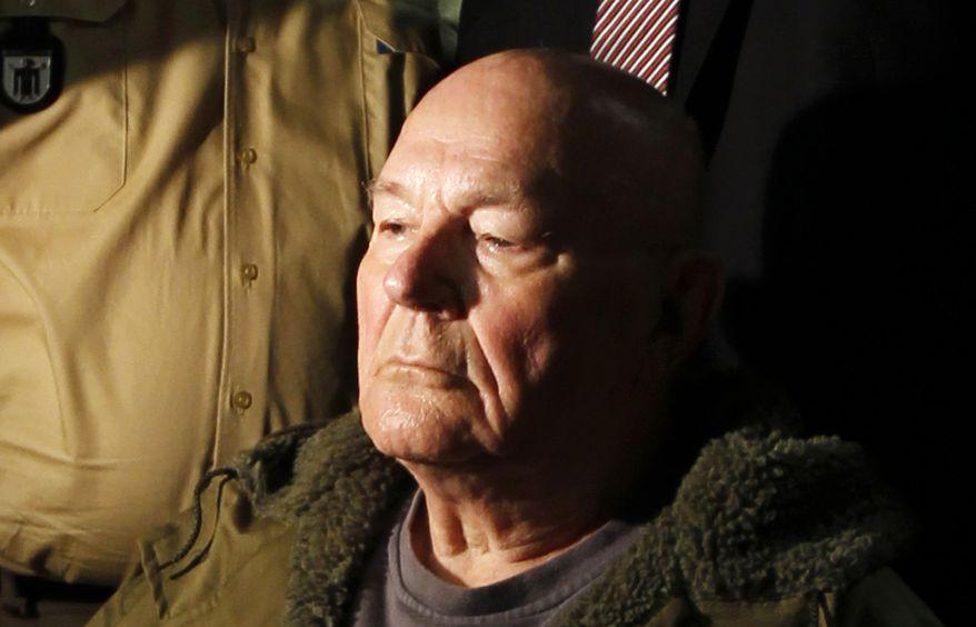 ** FILE ** John Demjanjuk waits in a Munich courtroom on Thursday, May 12, 2011. (AP Photo/Matthias Schrader)