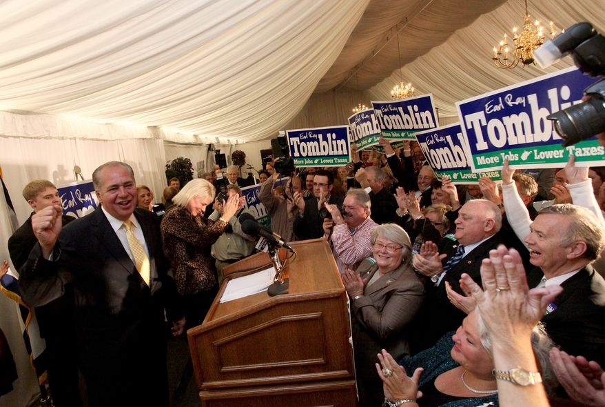 West Virginia acting Gov. Earl Ray Tomblin (left, at podium) celebrates Oct. 4, 2011, with supporters at his campaign headquarters at the Marriott Hotel in Charleston, W.Va., shortly after being declared the winner in the race for governor. (Associated Press)