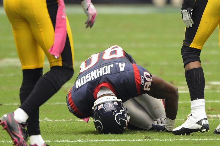 Houston Texans wide receiver Andre Johnson (80) falls to his knees in the second quarter of an NFL football game against the Pittsburgh Steelers Sunday, Oct. 2, 2011, in Houston. (AP Photo/Dave Einsel)