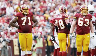 "T.J. KIRKPATRICK/THE WASHINGTON TIMES Left tackle Trent Williams (71) said there is less uncertainty when it comes to execution. ""There's not a lot of second-guessing as there was last year coming into a new system. I feel like we're all working together right now,"""