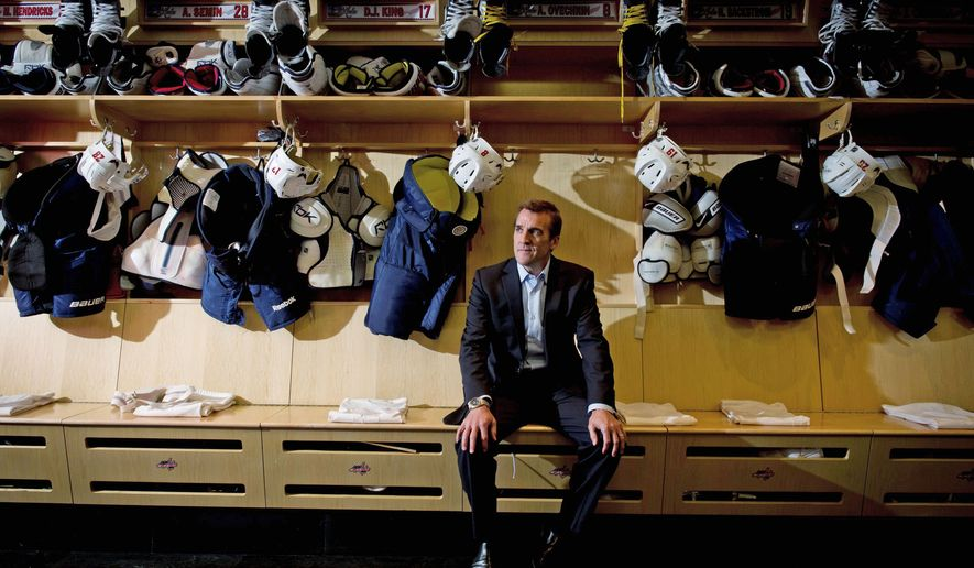 Rod Lamkey Jr. / The Washington Times BUILDING A WINNER: Washington Capitals GM George McPhee, in the locker room at Kettler Capitals Iceplex in Arlington, started rebuilding the team with Alex Ovechkin in the 2004 draft. Since then, he has added the pieces needed to make the team a consistent winner. <b>Video, washingtontimes.com/multimedia.</b>