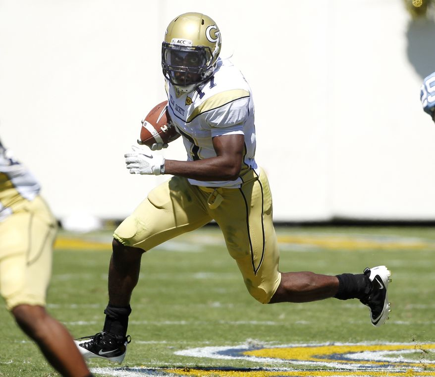 This Sept. 24, 2011 file photo shows Georgia Tech's Orwin Smith looking for running room during an NCAA college football game against North Carolina, in Atlanta. The Yellow Jackets' roll through five wins has inspired such momentum that running back Smith proclaimed he couldn't wait to play Clemson and Virginia Tech - even though Maryland visits Atlanta this week. (AP Photo/John Bazemore, File)