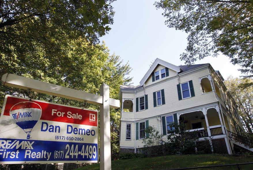 ** FILE ** A home in Newton, Mass., is up for sale on Monday, Sept. 19, 2011. (AP Photo/Steven Senne)