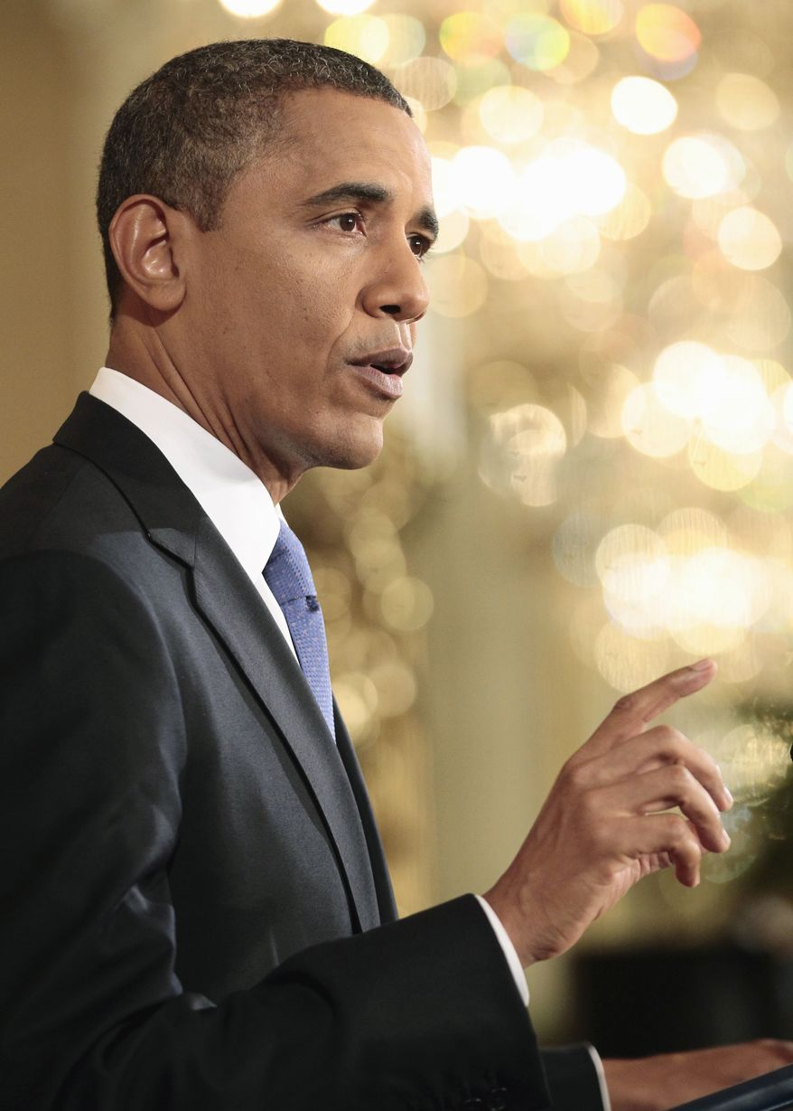President Barack Obama gestures during a news conference in the East Room of the White House in Washington, Thursday, Oct. 6, 2011. (AP Photo/Pablo Martinez Monsivais)