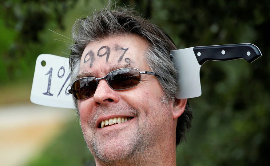 """Fred Doores takes part in an """"Occupy Austin"""" protest, Thursday, Oct. 6, 2011, in Austin, Texas. Concerns over Wall Street practices and economic inequality that have led to sit-ins and rallies in New York and elsewhere reverberated up to the White House on Thursday. (AP Photo/Eric Gay)"""