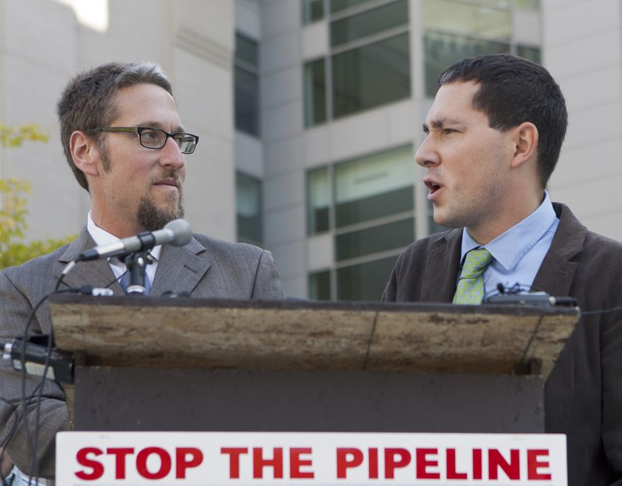 Erich Pica, president of Friends of the Earth, right, speaks in front of Federal Court in Omaha, Neb., Wednesday, Oct. 5, 2011, with Noah Greenwood, endangered species program director for the Center for Biological Diversity. Three groups, the Center for Biological Diversity, the Western Nebraska Resources Council and Friends of the Earth plan to file a lawsuit in federal court in Omaha, against TransCanada's Keystone XL pipeline, saying TransCanada has illegally cleared a 100-mile pipeline corridor through the Nebraska Sandhills, despite a federal law that prevents the launch of projects before they receive approval. (AP Photo/Nati Harnik)